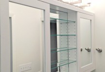 Mirrored Cabinet Doors and Glass Shelves